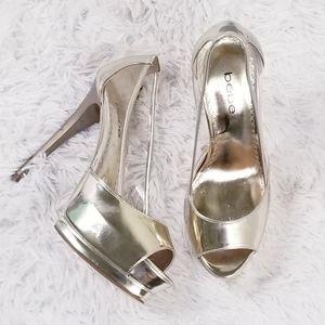 Bebe metallic gold and clear peep toe heels!